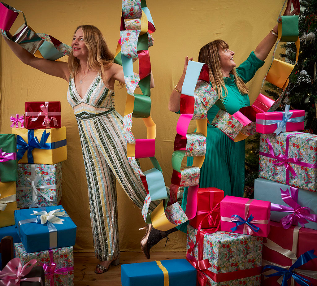 Amy Fleuriot-Reade and Bee Friedmann playing with paper chains, Artisans & Adventurers Christmas photoshoot