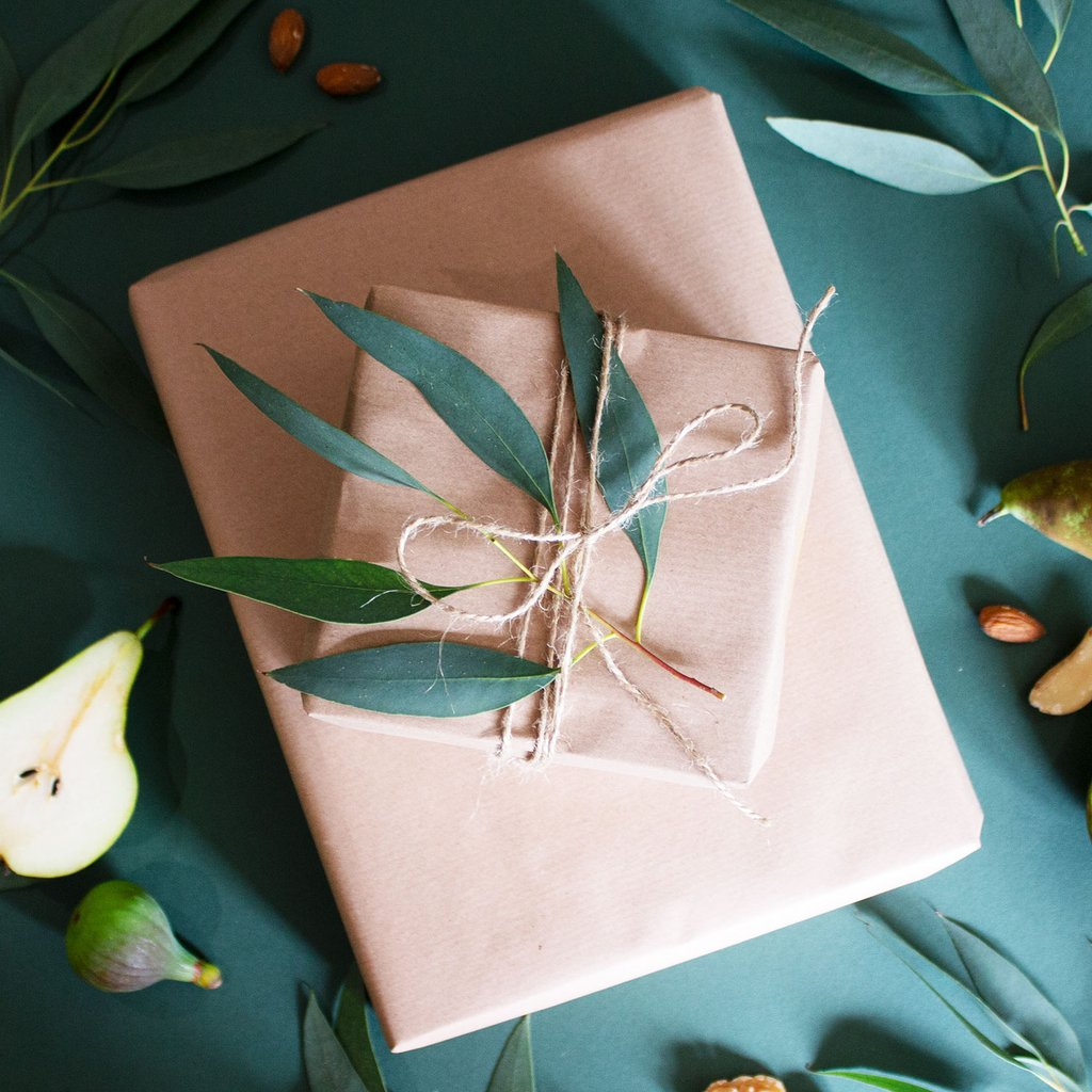 presents wrapped in brown kraft paper and tied with twine