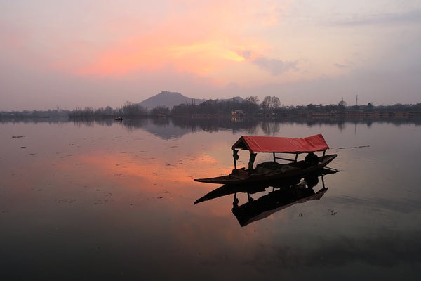 sunset over a lake in kashmir