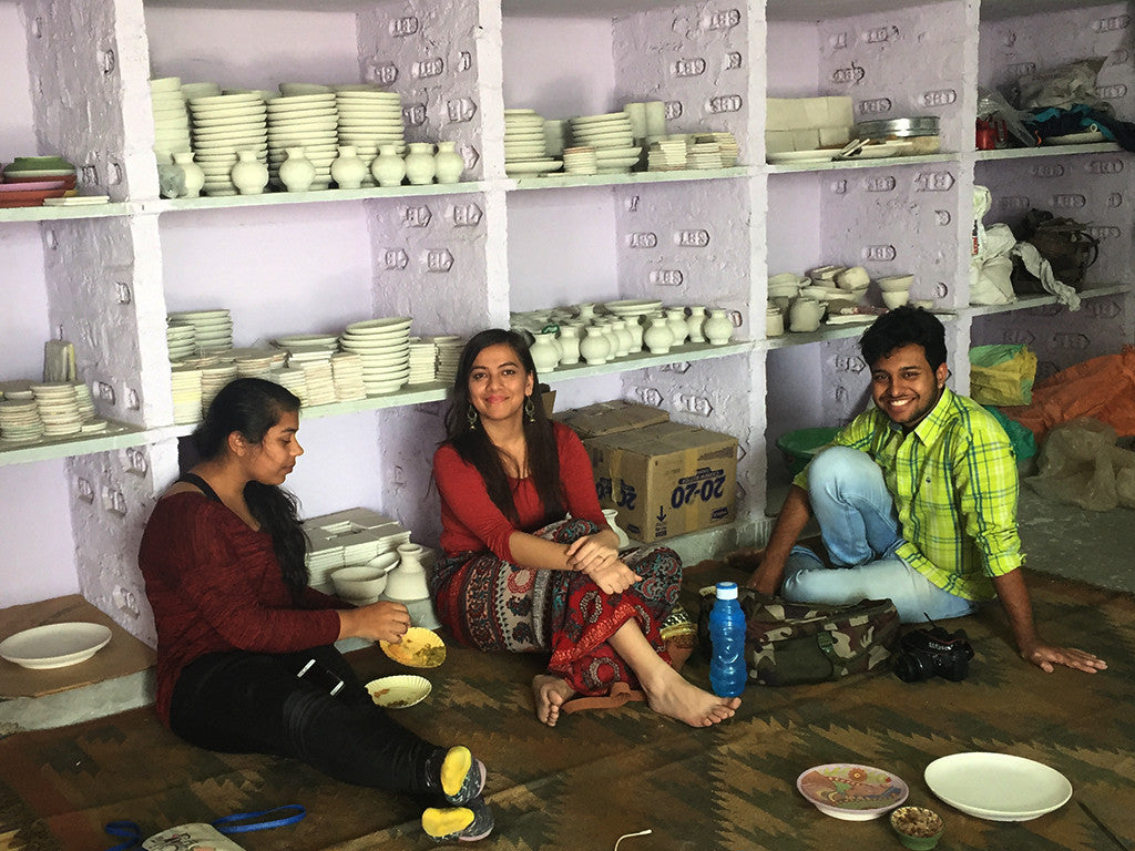 students learning blue pottery design jaipur india, artisans and adventurers