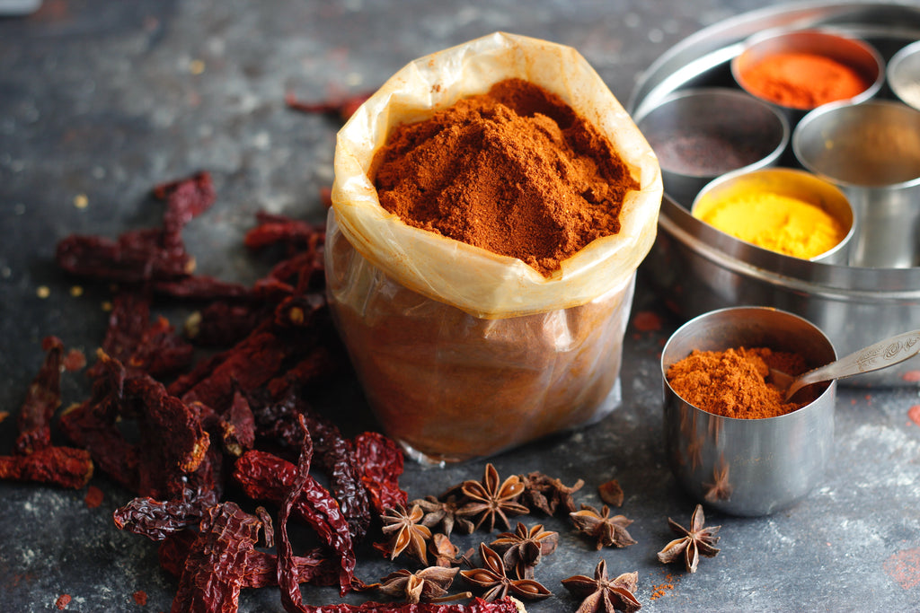 Spices in pots and a bag. Royalty free image by Prachi Palwe