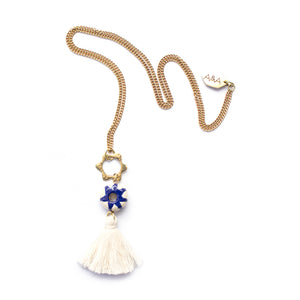 Artisans & Adventurers Iris Tassel Necklace - hand made with sustainable materials: cotton tassels, ceramic charm, and recycled brass