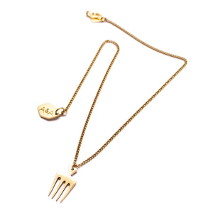 Artisans & Adventurers afro Comb Long Charm Necklace, produced in Kenya