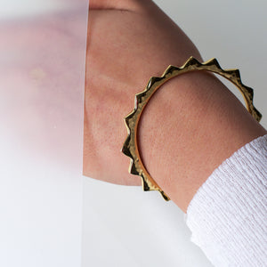 Ethical fashion brass, gold-toned, bangle by Artisans & Adventurers