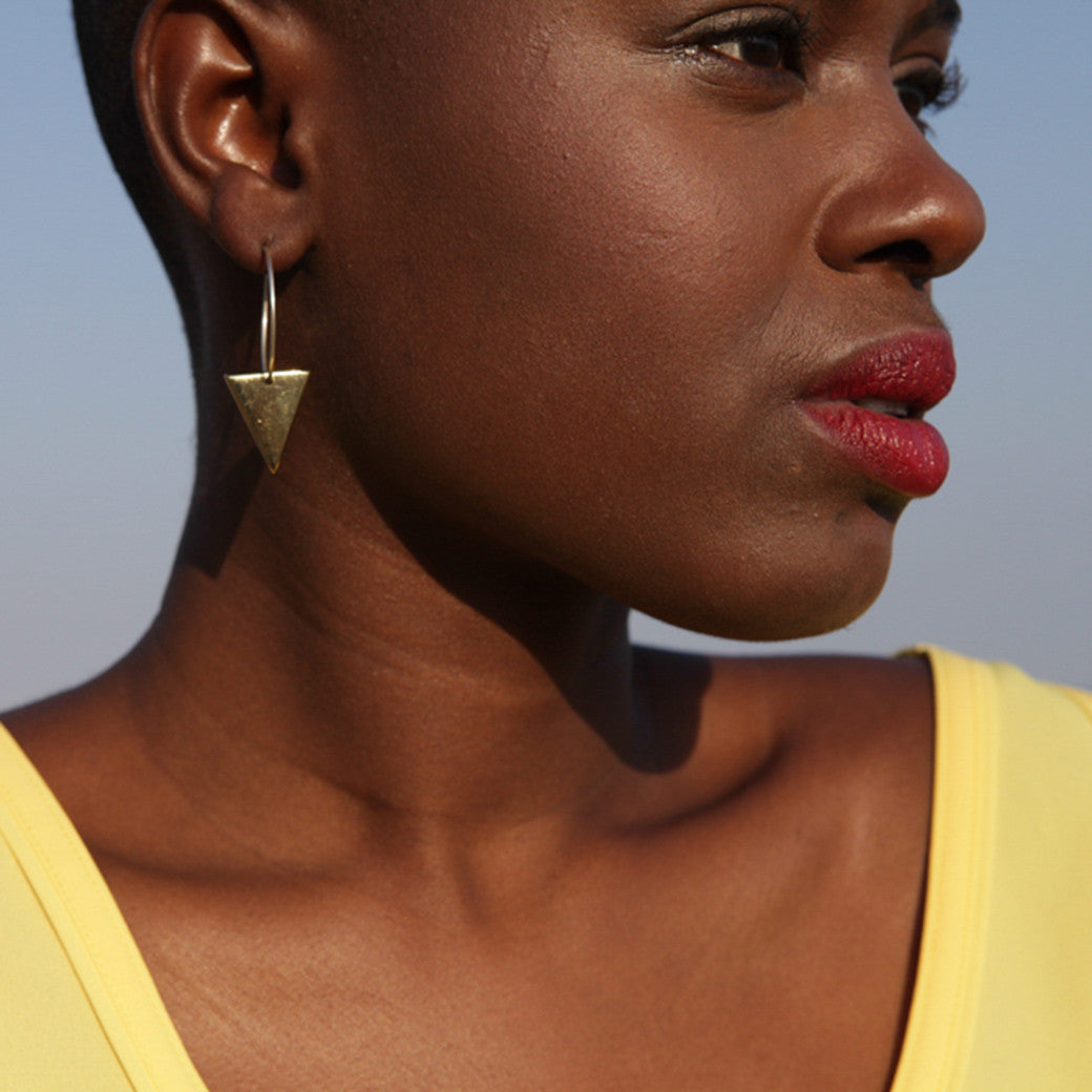 Artisans & Adventurers signature triangle hoop earrings and ethical jewellery collection london