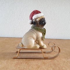Christmas Pug On Sled Figurine - The Chic Nest