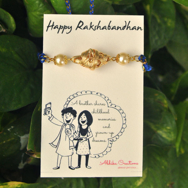Golden Bicone and Pearl Rakhi (ACRK027)