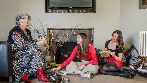Photo of Maxine Laceby, Darcy Laceby and Margot Laceby sitting together in a festively decorated sitting room