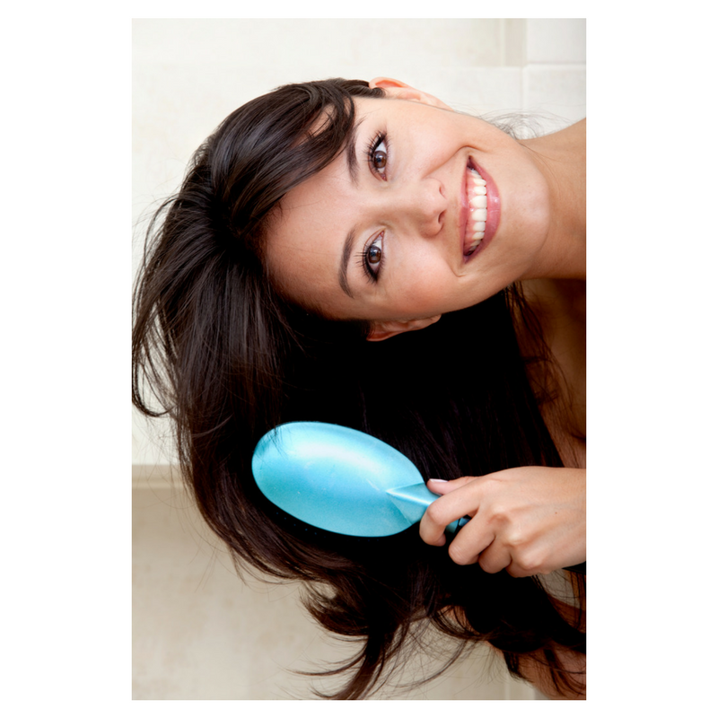 Woman combing healthy hair after taking collagen