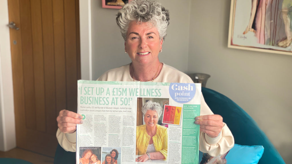 Photo showing Maxine Laceby holding up a copy of Closer magazine in which she is interviewed