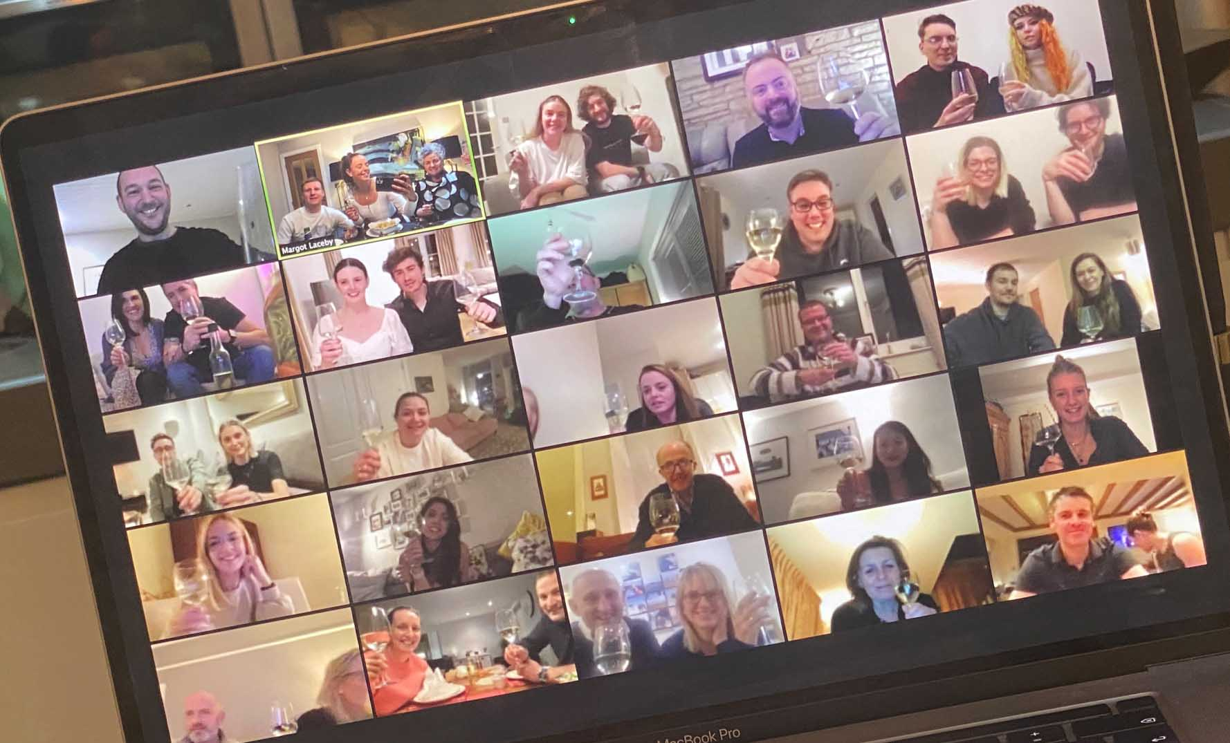 Photo of a laptop screen with the Absolute Collagen team enjoying wine and cheese on Zoom