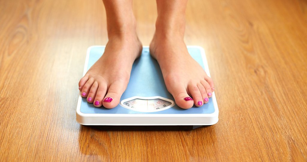 Woman on scales checking weight