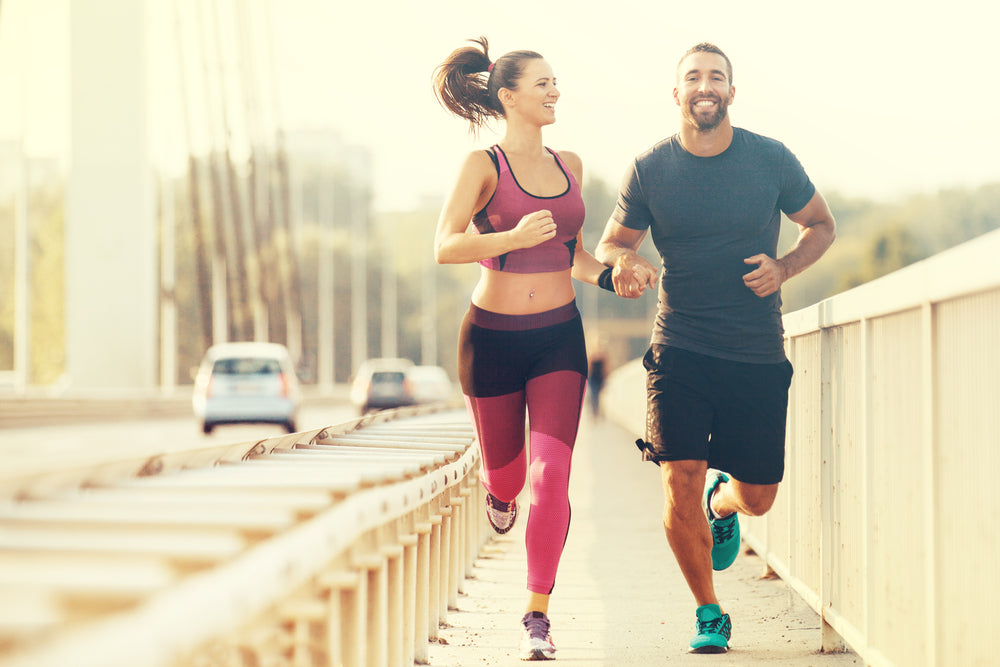 Couple running with Absolute Collagen