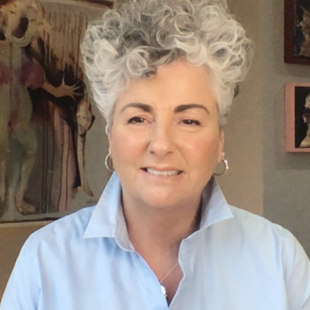 Photo of Maxine Laceby smiling slightly at the camera while wearing a light blue shirt