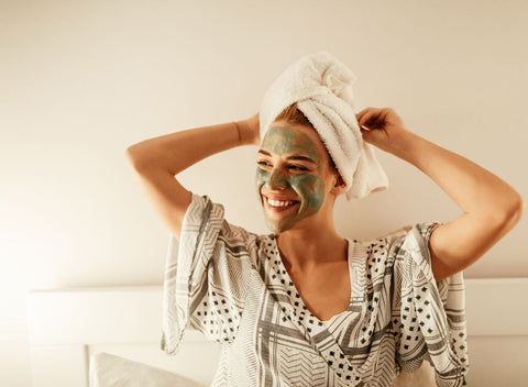 Woman with face mask and towel. Try pampering yourself to beat the January blues and blue monday - absolute collagen
