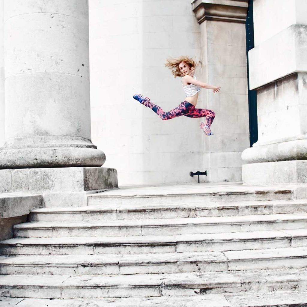 Charlotte Tooth dancer leaping on steps