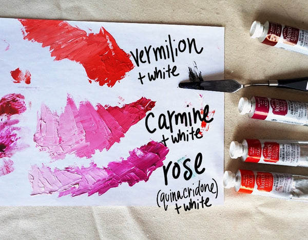 Tubes of Master's oil paint laid out beside a palette. White has been mixed with three of the colours to make tints, vermilion, carmine and rose.