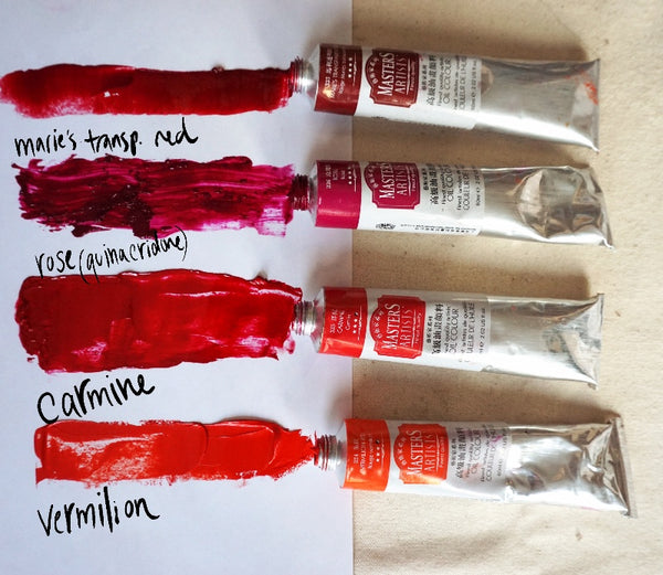 Four tubes of Master's oil paint, in vermilion, carmine, rose and Marie's transparent red, with streaks of paint from each tube spread out on a palette
