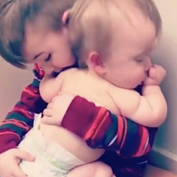 Big Brother Rocks Sick Little Sister to Sleep