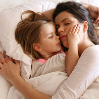 Is Lying Down with Your Kids Until They Fall Asleep a Bad Habit?