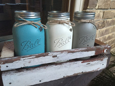 Distressed mason jars in rustic barnwood boxes