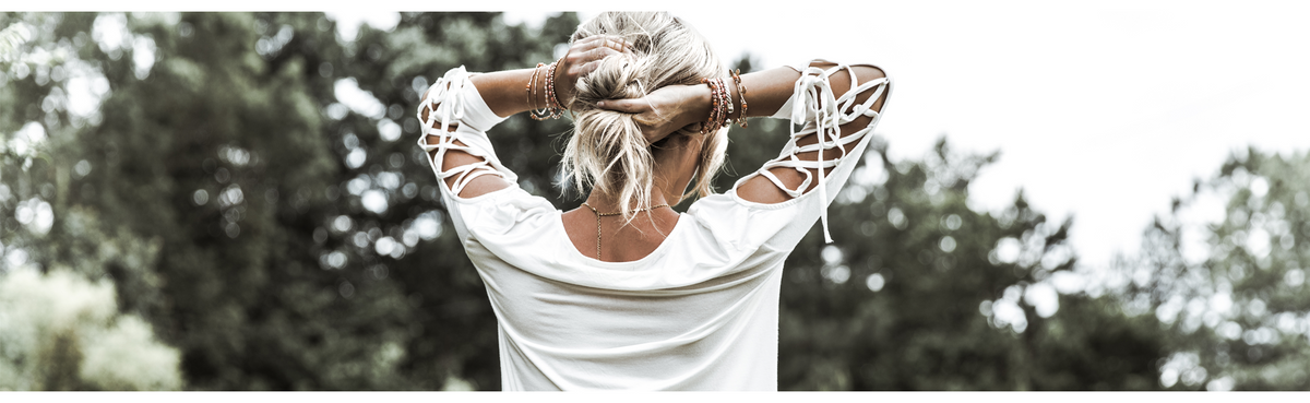 boho chic look with woman holding her hair