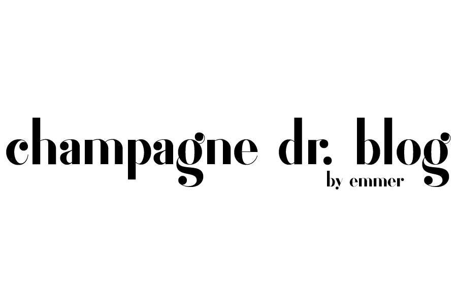 text logo that says champagne drive blog by emmer