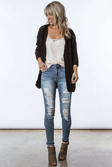 black knit cardigan and distressed jeans