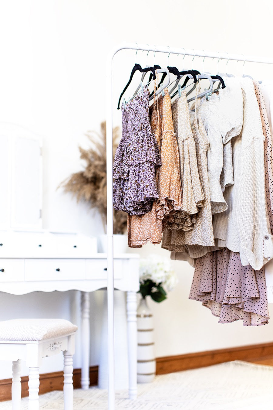 women casual spring style on a rack in a sunny room