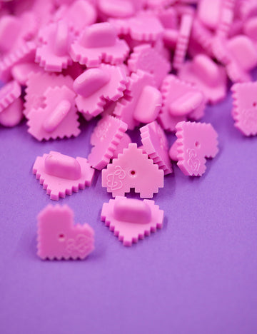 PIXEL HEART Shaped rubber pin backs!