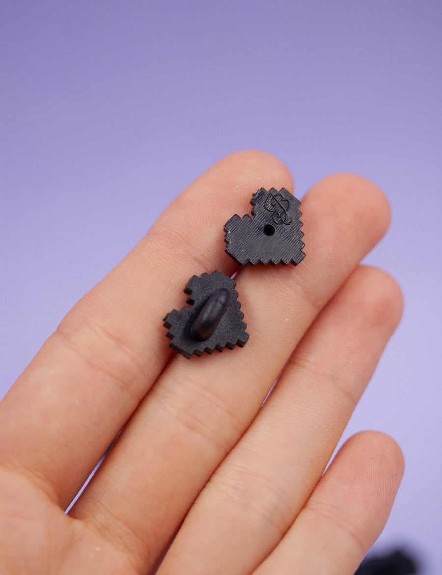 BLACK PIXEL HEART Shaped rubber pin backs!