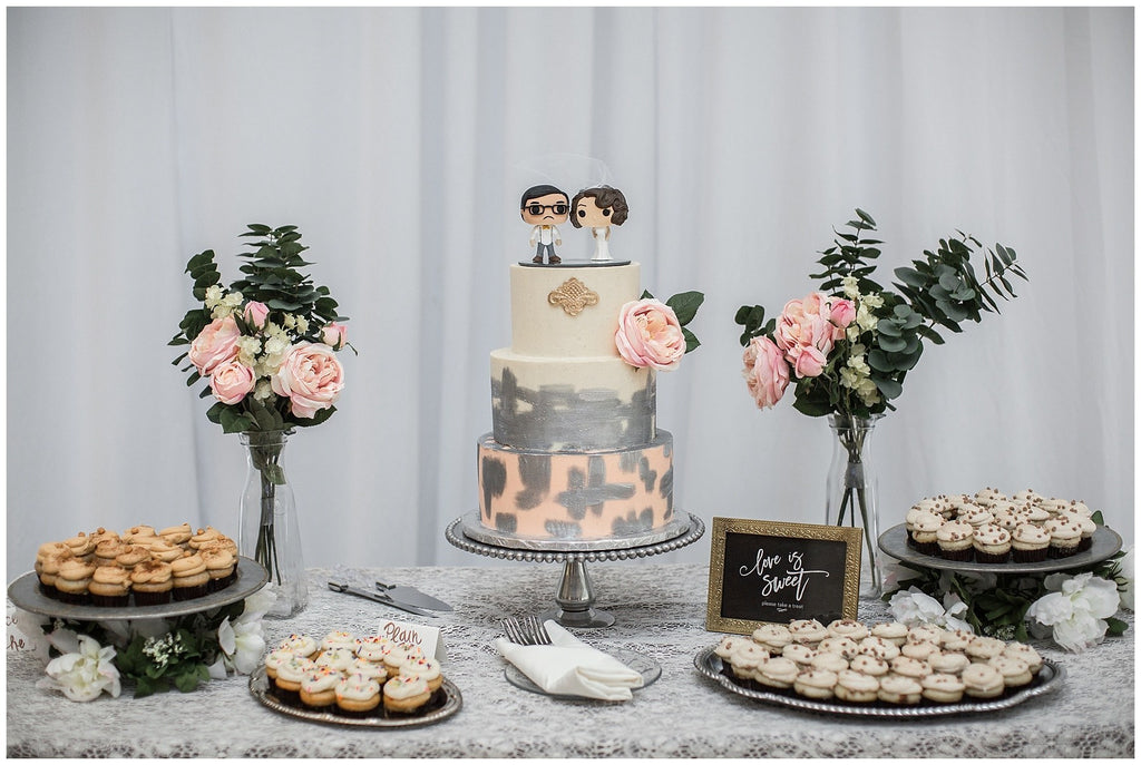 blush pink and mustard yellow wedding dessert table with cake, cupcakes and cookies
