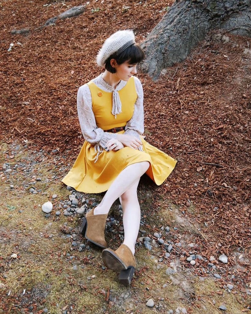 shop apricity | JANUARY Dress | Mustard yellow short ponte knit party dress with back bow and pockets. retro french girl style mustard yellow dress with tights and boots. how to wear dresses in the fall and winter. short yellow dress with bows and pockets