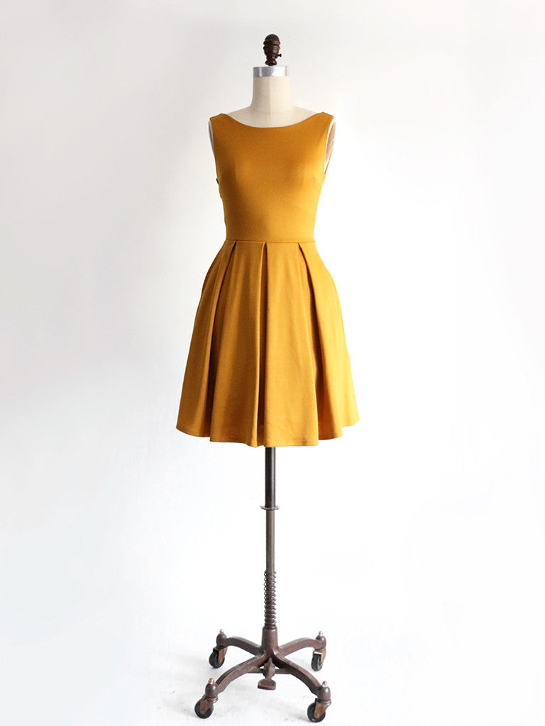 shop apricity | JANUARY Dress | Mustard yellow short ponte knit party dress with back bow and pockets. short yellow bridesmaid dress. short yellow party dress with bow and pockets. 1960s mod retro vintage modern dress