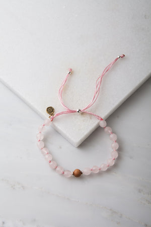 The Mala Babe Pink Rose Quartz Knotted Mala Bracelet on marble