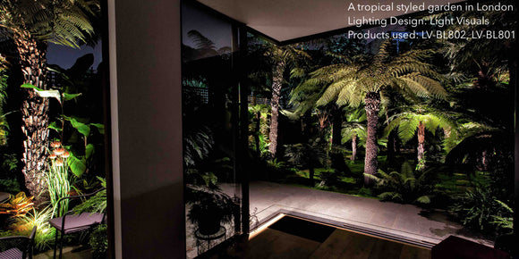 An image of a tropical garden in London, with garden lighting designed by Light Visuals