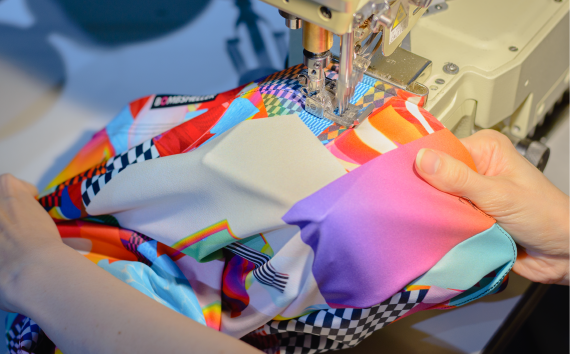 TrapperKeeper being sewn at an industrial machine.