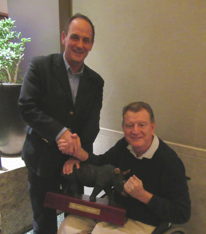Rhino CEO Reg Clark presents SKRUM's Michael Collinson with Rhino Grassroots Rugby Award