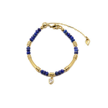 Genuine faceted lapis beaded stone from Camille Jewelry. Gold plated tube style.