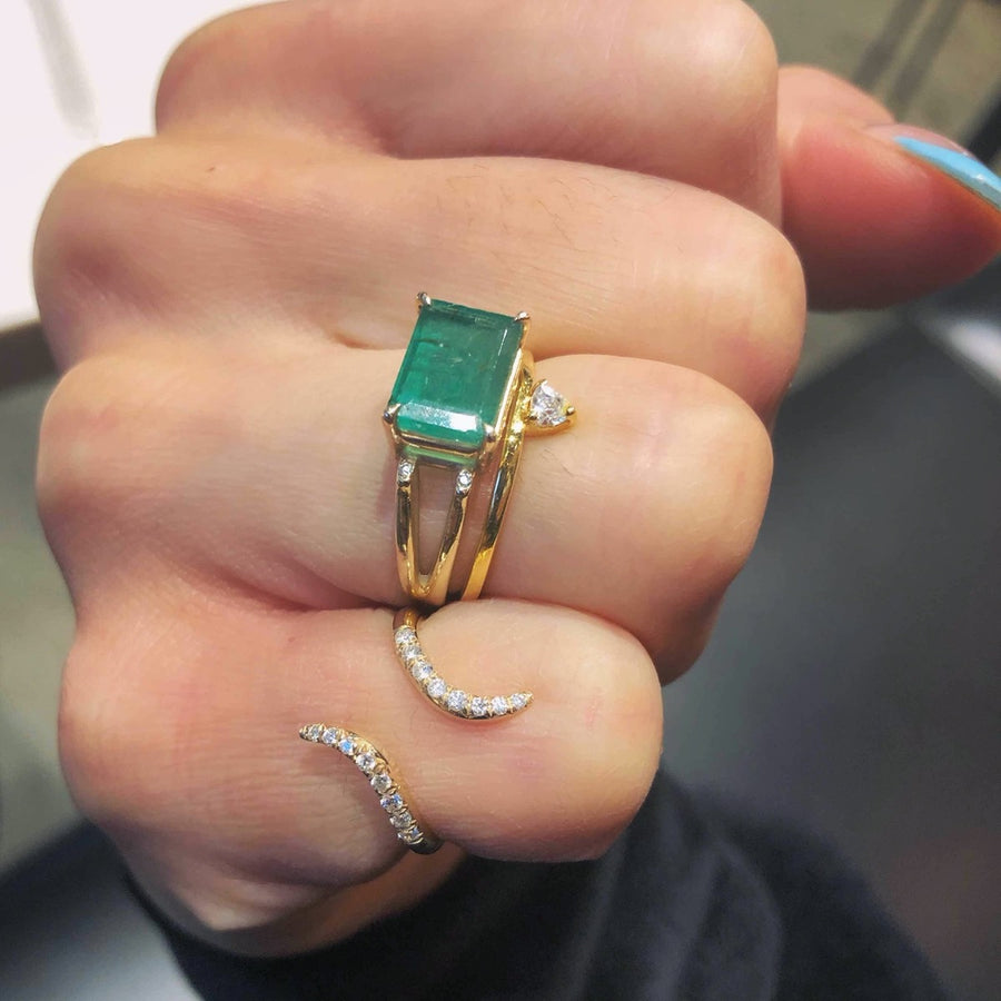 Emerald gold ring with diamond accents at Camille Jewelry