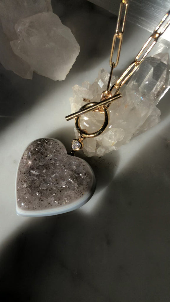 Quartz heart druzy pendant on 14K gold filled paperclip chain with toggle front closure at Camille Jewelry.