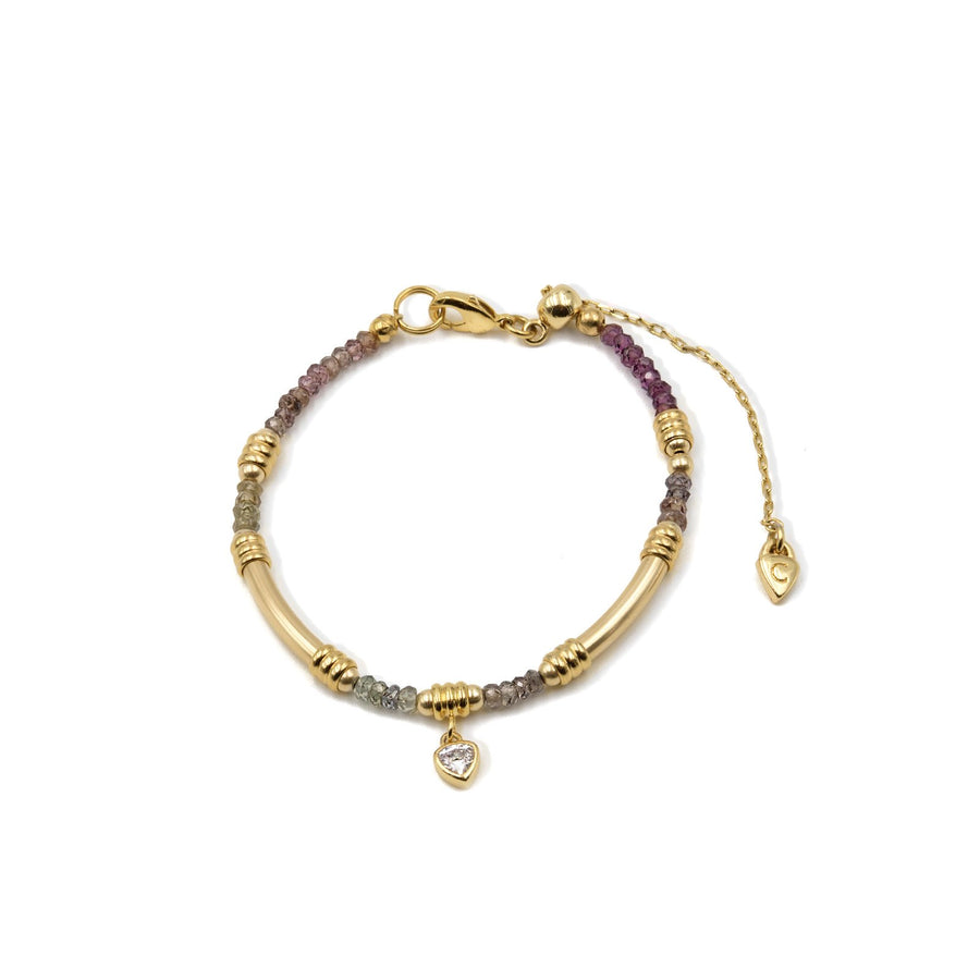 Genuine garnet beaded bracelet with gold plated tube styling. Shop Camille Jewelry