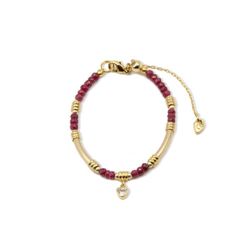 Genuine ruby rondel beads with gold plated tube style bracelet from Camille Jewelry.