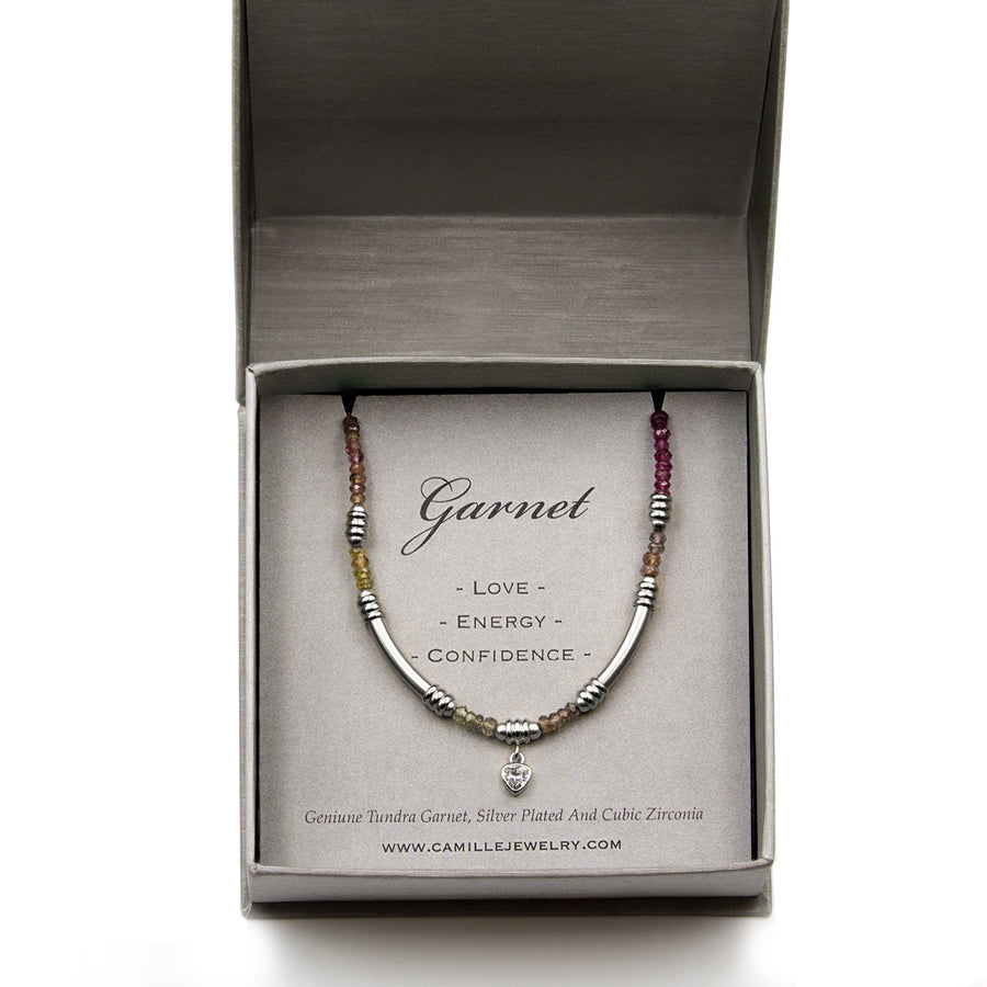 Beaded genuine garnet bracelet with silver plated tube detailing with charm. Shop Camille Jewelry
