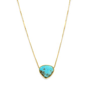 Camille Jewelry - Kingman turquoise teardrop pendant on gold filled station chain.