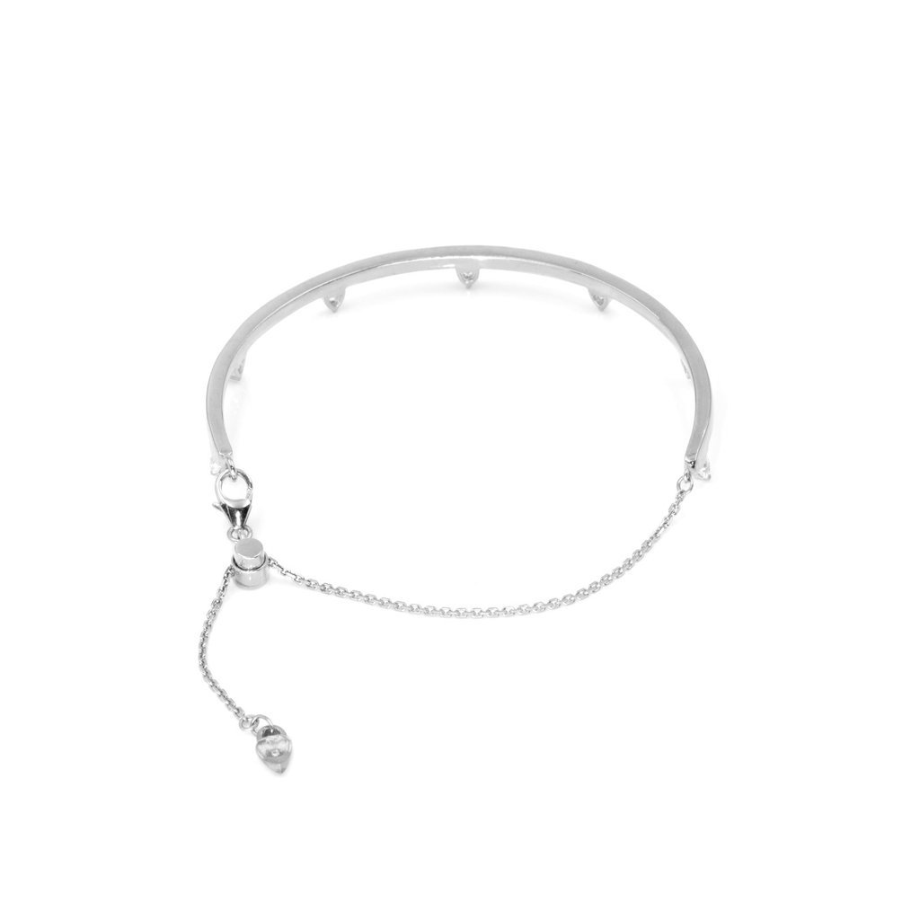 Camille Jewelry- Theia collection,  rhodium plated sterling silver bangle with adjustable chain. Trillion stones in cubic zirconia. Free shipping USA.