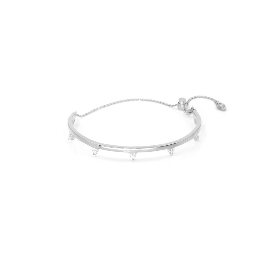 Rhodium plated sterling silver bangle with cubic zirconia trillion stones | Camille Jewelry