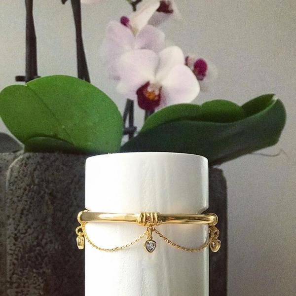 Camille Jewelry- Thyra charm swag hinged gold bangle bracelet.