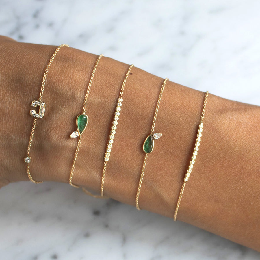 Delicate fine jewelry bracelets set in diamonds and emerald in 14K gold | Shop Camille Jewelry