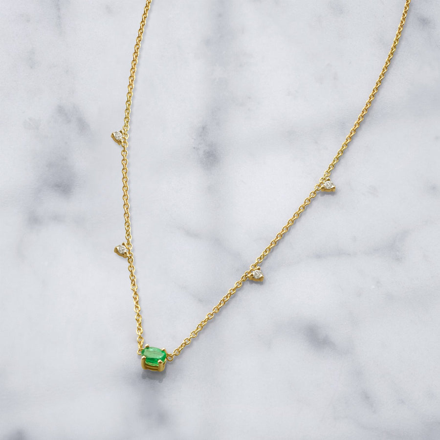 Camille Jewelry - 14K gold necklace with center oval emerald prong stone and delicate prong diamonds.